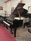 Piano for sale. A 1983, Yamaha G3 grand piano for sale with a black case and spade legs