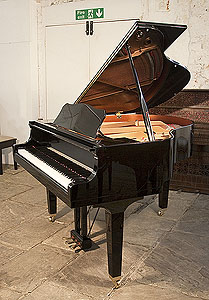 A 2013, Yamaha GB1 baby grand piano for sale with a black case and square, tapered legs. Piano lid has a slow fall mechanism.