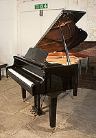 A 1978, Yamaha GB1 baby grand piano for sale with a black case and square, tapered legs. Piano has an eighty-eight note keyboard and a three-pedal lyre.