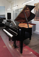 A 2012, Yamaha GB1 baby grand piano for sale with a black case and square, tapered legs. Piano has an eighty-eight note keyboard and a three-pedal lyre.