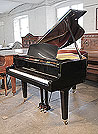 Piano for sale. A 1988, Yamaha GH1 baby grand piano for sale with a black case and square, tapered legs. Piano has an eighty-eight note keyboard and a three-pedal lyre
