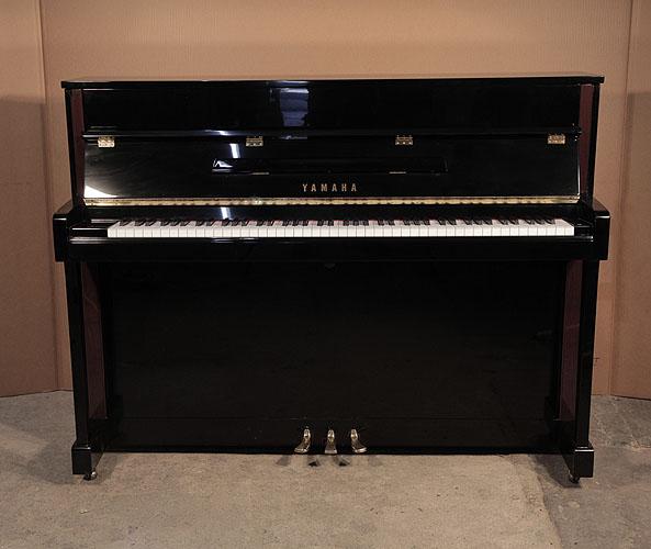 Yamaha upright Piano for sale.