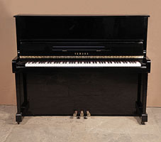 A 1988, Yamaha MC10Bl upright piano with a black case and polyester finish