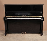 Piano for sale. A 1988, Yamaha MC10Bl upright piano with a black case and polyester finish