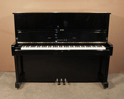 A 1977, Yamaha U1  upright piano with a black case and polyester finish