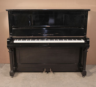 A 1962, Yamaha U2upright piano with a black case and polyester finish. Piano has an eighty-eight note keyboard and three pedals.