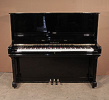 A 1972, Yamaha U3 upright piano with a black case and polyester finish