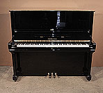 Piano for sale. A 1972, Yamaha U3 upright piano for sale with a black case and brass fittings. Piano has an eighty-eight note keyboard and three pedals.