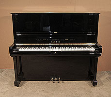 A 1973, Yamaha U3 upright piano with a black case and polyester finish