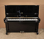 Piano for sale. A 1973, Yamaha U3 upright piano for sale with a black case and brass fittings. Piano has an eighty-eight note keyboard and three pedals.