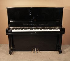 A 1975, Yamaha U3  upright piano with a black case and polyester finish