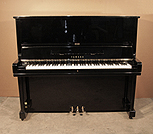 Piano for sale. A 1975, Yamaha U3 upright piano for sale with a black case and brass fittings. Piano has an eighty-eight note keyboard and three pedals.