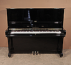 Piano for sale. A 1976, Yamaha U3 upright piano for sale with a black case and brass fittings. Piano has an eighty-eight note keyboard and three pedals.
