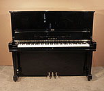 Piano for sale. A 1969, Yamaha U3 upright piano for sale with a black case and brass fittings. Piano has an eighty-eight note keyboard and three pedals.