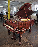 A Decker Bros grand piano for sale with a quartered oak case, filgree music desk and fluted, turned legs