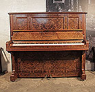 An 1894, Bechstein upright piano with a polished, burr walnut case. Piano has an eighty-eight note keyboard and two pedals.