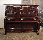 An 1897, Arts and Crafts style, Bechstein upright piano with a mahogany case, fretwork panels and ornate brass hinges in a stylised floral design Piano has an eighty-eight note keyboard and two pedals.
