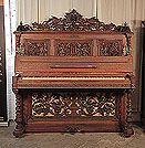 Piano for sale. Renaissance style, Biese Hof upright piano for sale with an ornately carved, mahogany case and barley sugar legs