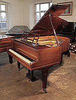 A 1930, Bluthner grand piano for sale with a mahogany case, openwork music desk and square, tapered legs