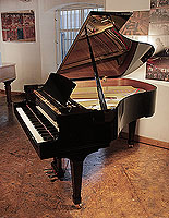 A 2001, Boston GP178 II grand piano for sale with a black case and spade legs. Piano has an eighty-eight note keyboard and a three-pedal lyre