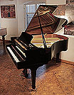 Piano for sale. A 2001, Boston GP178 II grand piano for sale with a black case and spade legs. Piano has an eighty-eight note keyboard and a three-pedal lyre.