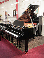 Piano for sale. W. Hoffmann grand piano with a black case and spade legs