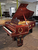 Piano for sale. Empire style, 1901, Ibach model 2 grand piano for sale with a mahogany case and gate legs. Entire cabinet decorated with ormolu mounts featuring scenes of greek gods and goddesses and wreaths.