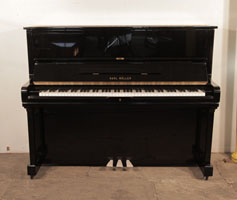Karl Muller Upright Piano For Sale with a Black Case and Brass Fittings.