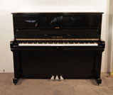 Piano for sale. Karl Muller Upright Piano For Sale with a Black Case and Brass Fittings.