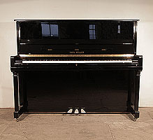 Karl Muller Upright Piano For Sale with a Black Case and Brass Fittings. Piano has an eighty-eight note keyboard and three pedals.