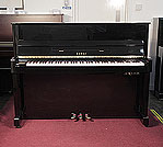 Piano for sale. A 2000, Kawai CX-5H upright piano with a black case and fitted Kawai silent system