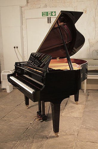 A Kawai GL-10 baby grand piano for sale with a black case and square, tapered legs