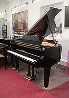 Kawai GL-10 grand piano for sale with a black case and square, tapered legs. Piano has an eighty-eight note keyboard and a three-pedal lyre.