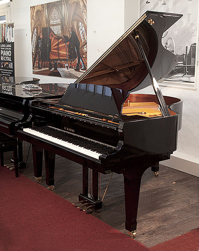 Piano for sale. A Kawai GX-2 grand piano for sale with a black case and fitted PianoDisc SilentDrive HD system. Piano has an eighty-eight note keyboard and a three-pedal lyre.