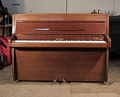 A 1960, Knight upright piano for sale with a polished, mahogany case . Piano has an eighty-eight note keyboard and and two pedals