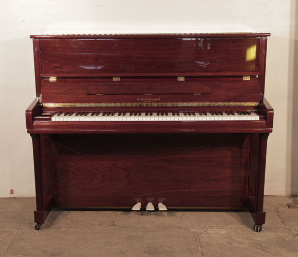 Kohler & Campbell upright piano for sale with a walnut case and polyester finish