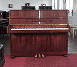 Piano for sale. Opus upright piano with a mahogany case and polyester finish. Piano has an eighty-eight note keyboard and three pedals