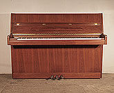 Piano for sale. Ottostein CS-108  upright piano with a crown cut, satin, walnut case