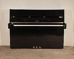 Ottostein SU-108P upright piano for sale with a black case and brass fittings. Piano has an eighty-eight note keyboard and three pedals.