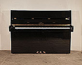 Piano for sale. Ottostein SU-108P upright piano with a  black case and brass fittings