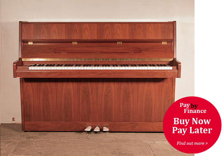 Ottostein upright piano for sale with a satin, walnut case
