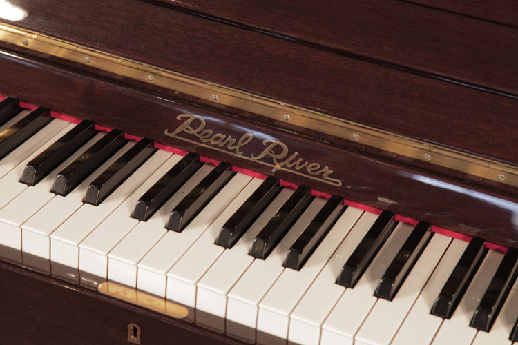 Pearl River Upright Piano for sale.