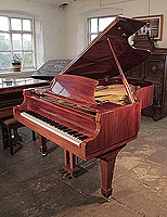 A 1987, Reid-Sohn grand piano for sale with a mahogany case and spade legs