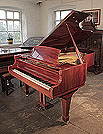 Piano for sale. A 1987, Reid-Sohn grand piano for sale with a mahogany case and spade legs. Piano has an eighty-eight note keyboard and a three-pedal lyre.