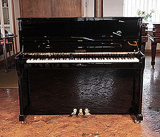Brand new, Sauter Ragazza upright piano for sale with a polished, black case. Piano features a double repetition action, and damping pedal. 100% made in Germany.