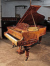 Piano for sale. Antique, Schiedmayer baby grand piano with an exquisite, burr walnut case and turned, faceted legs. Cabinet features a filigree music desk and piano cheeks carved with scrolling acanthus.