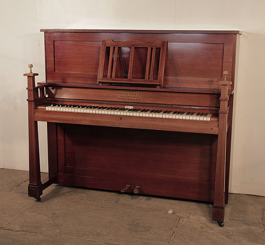 SArts and Crafts style, 1905, Schiedmayer upright piano for sale with a mahogany case and sculptural candlesticks
