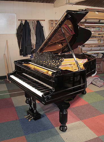 An 1880, Steinway Model A grand piano for sale with a black case, filigree music desk and fluted, barrel legs