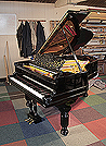 An 1880, Steinway Model A grand piano for sale with a black case, filigree music desk and fluted, barrel legs. Piano has an eighty-five note keyboard and a three-pedal lyre.