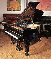 Rebuilt, 1886, Steinway Model A grand piano for sale with a black case, filigree music desk and fluted, barrel legs. Piano has an eighty-five note keyboard and a two-pedal lyre.